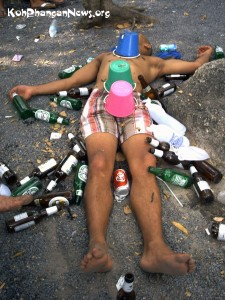 Western tourist enjoying the rubbish at the Original Full Moon Party in Koh Phangan