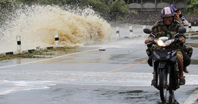 A motorcyclist rides among crashing waves at a beach in Chumphon. (Photo with friendly support from Bangkok Post by Amnard Thongdee)