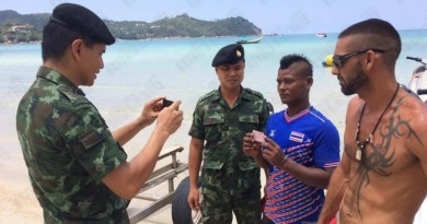 Soldiers arrest jet ski operator at Thong Nai Pan bay on Koh Phangan Island