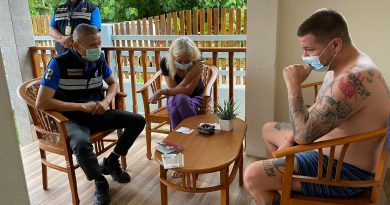An immigration police officer interrogates one of two German drugs fugitives arrested on Tuesday morning.