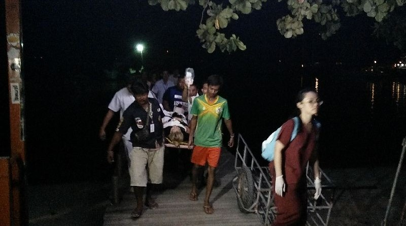 Rescue workers bring a 20-year-old tourist who was struck by a boat turbine to a hospital on Koh Samui