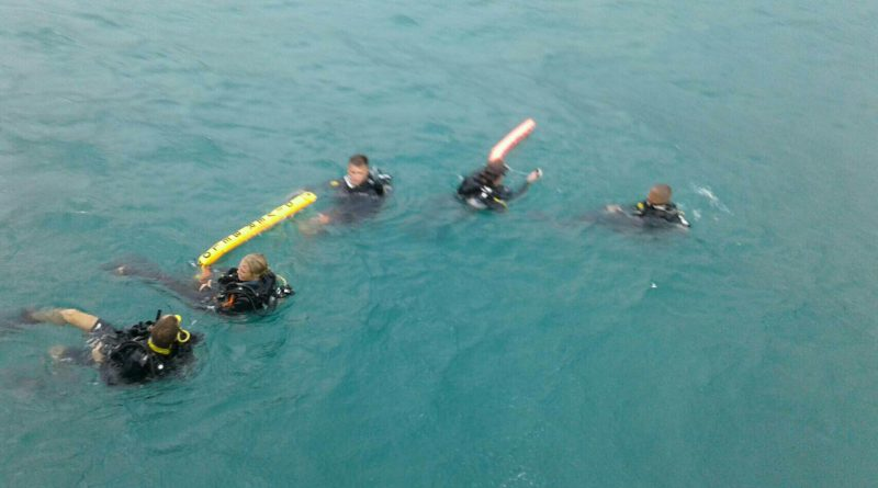 Diving instructors search for Irie Takuma on Wednesday just off Koh Phangan, where he went missing Tuesday. Photo by KhaoSodEnglish @ Asaree Thaitrakulpanich